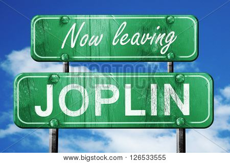 Now leaving joplin road sign with blue sky