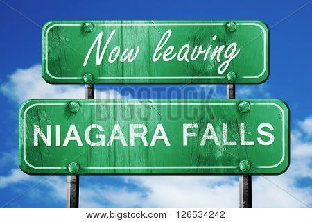 Now leaving niagara falls road sign with blue sky