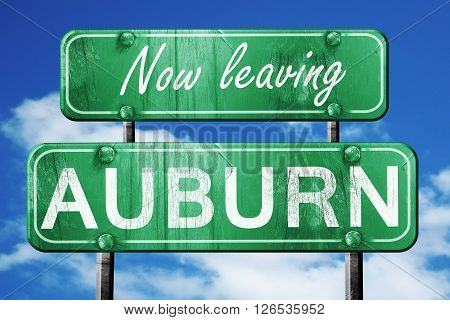 Now leaving auburn road sign with blue sky