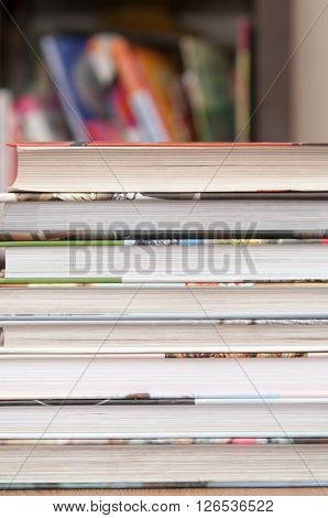 Stack of books with the pages facing towards the camera
