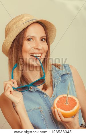 Flirty Woman In Hat Hold Sunglasses And Grapefruit
