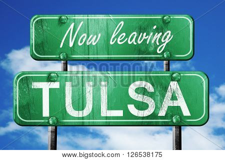 Now leaving tulsa road sign with blue sky