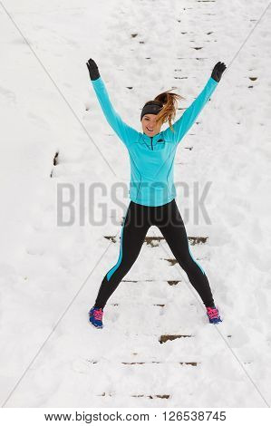 Woman fit fitness girl exercising in the snow winter sport health concept