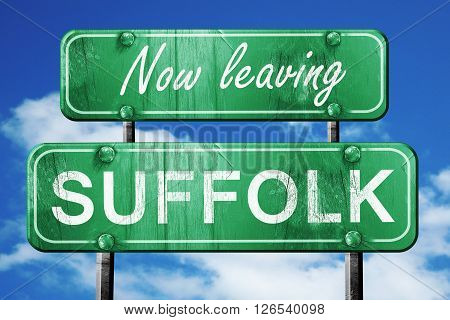 Now leaving suffolk road sign with blue sky