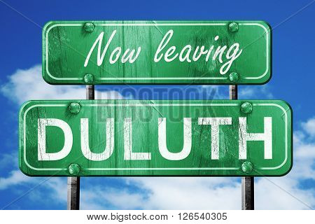 Now leaving duluth road sign with blue sky