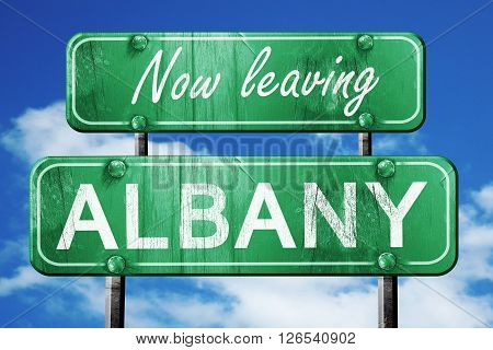 Now leaving albany road sign with blue sky