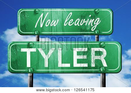 Now leaving tyler road sign with blue sky