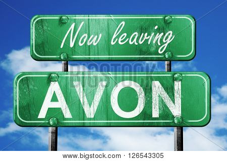 Now leaving avon road sign with blue sky