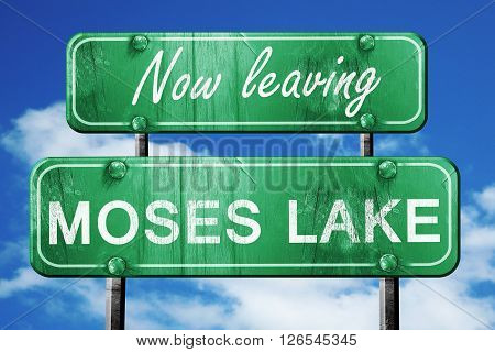Now leaving moses lake road sign with blue sky