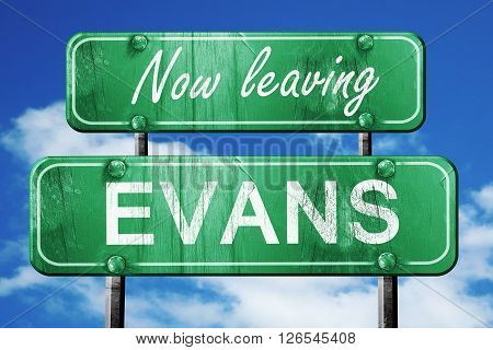 Now leaving evans road sign with blue sky