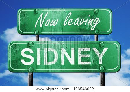 Now leaving sidney road sign with blue sky