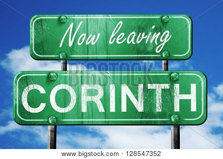 Now leaving corinth road sign with blue sky