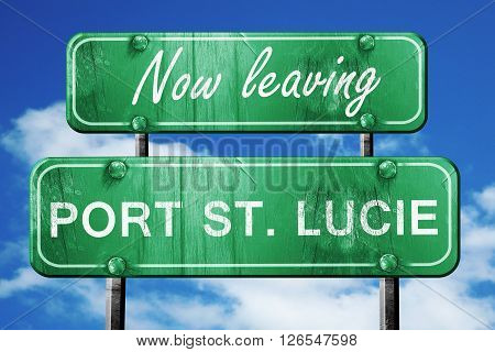 Now leaving port st. lucie road sign with blue sky