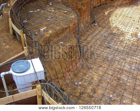 Outdoor swimming pool under construction close up.