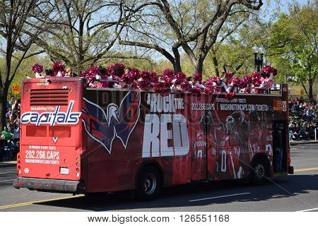 WASHINGTON, DC - APR 16: Double decker bus at the 2016 National Cherry Blossom Parade in Washington DC, as seen on April 16, 2016. Thousands of visitors gathered to attend this annual event.
