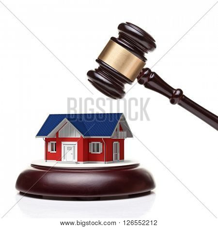 wooden judge gavel and 3d m odel house