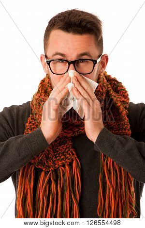 Man With Flu And Fever Wrapped In Scarf Sneezing Into Handkerchief.
