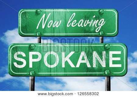 Now leaving spokane road sign with blue sky