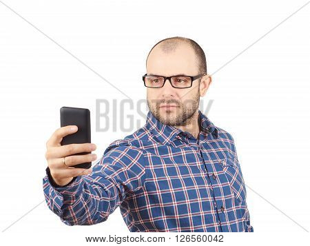 Caucasian Man With Glasses Making A Selfie.