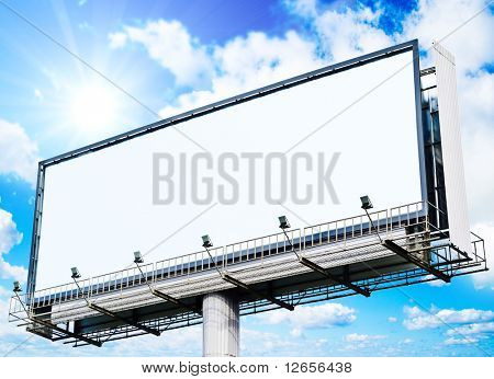 huge white blank billboard and a sun