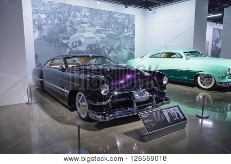 Los Angeles, CA, USA -- April 16, 2016: Purple 1948 Cadillac Sedanette reproduction called CadZZilla by Hot Rods by Boyd from the collection of rock band ZZ Top guitarist Billy Gibbons at the Petersen Automotive Museum in Los Angeles, California, United S