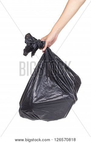 Hand holding black bag of rubbish on white background