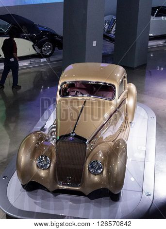 Los Angeles, CA, USA -- April 16, 2016: Gold 1937 Delage D8-120 Coupe Aerosport by Letourneur et Marchand at the Petersen Automotive Museum in Los Angeles, California, United States.