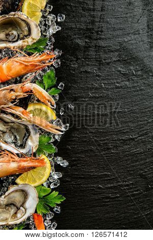 Seafood served on black stone