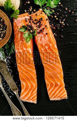 Salmon filets served on black stone