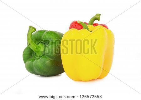 Bell pepper three colors red yellow and green isolated on white background.