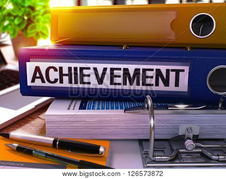Blue Office Folder with Inscription Achievement on Office Desktop with Office Supplies and Modern Laptop. Achievement Business Concept on Blurred Background. Achievement - Toned Image. 3D.