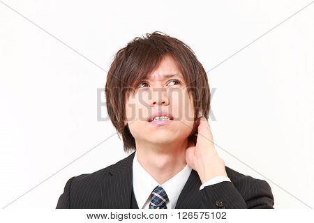 studio shot of perplexed businessman on white background