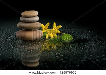 Balancing Zen Stones On Black With Yellow Flower