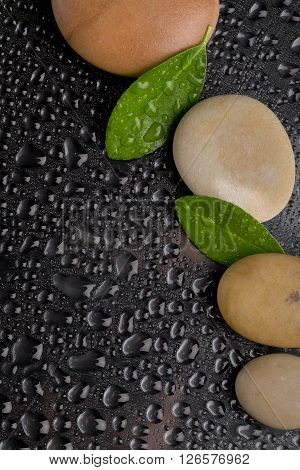 Zen Stones On Black With Water Drops