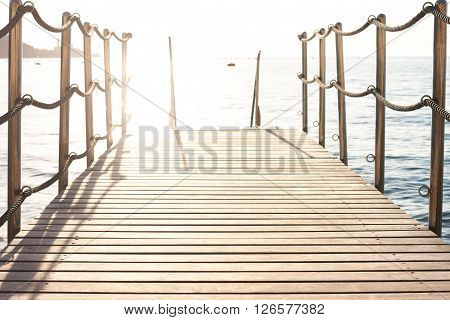 small pier on background of sunset over the Adriatic sea