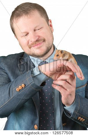 Man holding hamster on arm on white background