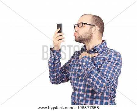 Caucasian Man Doing A Selfie With A Kiss.