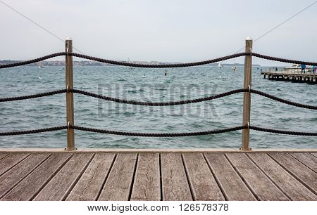 Empty wooden seafront with fence can be used as background