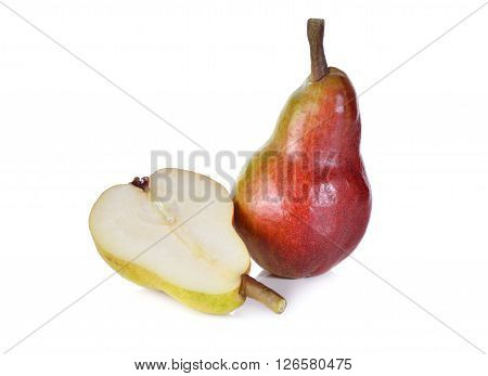 whole and half cut red pear with stem on white background