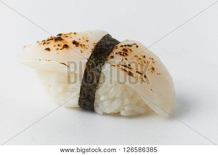 sushi from rice, sea scallop and nori on a white background