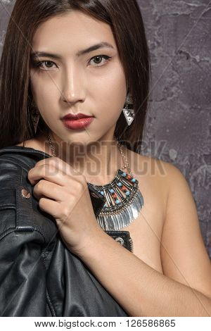 Portrait Of The Asian Girl With A Bare Shoulder