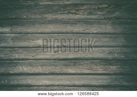 Logs wall of old rural house wooden background toned image