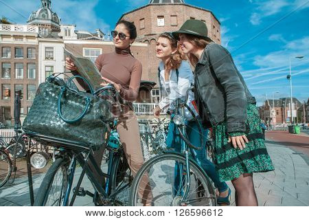 Three friends exploring the Dutch capital on bikes