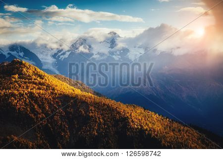 Nice views of the foot of Mt. Ushba illuminated by sunlight. Dramatic and picturesque morning scene.. Location famous place Mestia, Upper Svaneti, Georgia, Europe. High Caucasus ridge. Beauty world.
