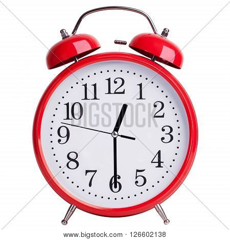 Round red alarm clock shows half of the first