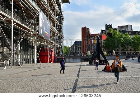 Paris France - May 14 2015: People visit Centre of Georges Pompidou on May 14 2015 in Paris France. The Centre of Georges Pompidou is one of the most famous museums of the modern art in the world.