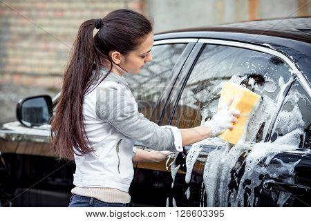 Girl Washes The Car