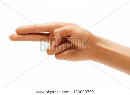 Woman's hand making shooting gun gesture. Shooting two fingers isolated on white background. High resolution product. Close up