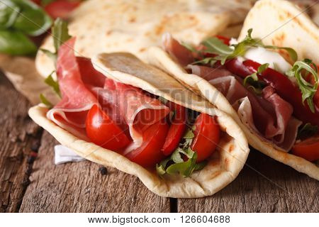 Italian Piadina Flatbread Stuffed With Ham And Vegetables Close-up. Horizontal