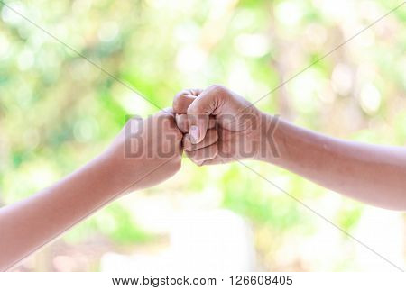 Father And Boy Hands - Fist Bump